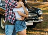 Love And Affection Between A Young Couple At The Park. A Guy In A Plaid Plane And Jeans, A Girl In S poster