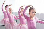 Beautiful Kids In Pink Tutu Skirts Dancing In Ballet School poster