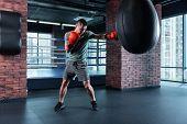 Boxing Hard. Strong Professional Skillful Athlete Wearing Grey Shorts And Khaki Shirt Boxing Hard We poster