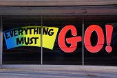 stock photo of going out business sale  - A going out of business window sign advertising that everything must go - JPG