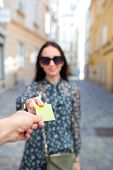 Closeup Shot Of A Woman Passing A Payment Credit Card. Girl Holding A Credit Card. Shallow Depth Of  poster