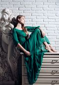 Fashion Model In Trendy Dress. Art And Sculpture. Woman Artist Dream And Think At Gypsum Sculpture A poster