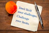 Do not limit your challenges. Challenge your limits. Inspirational handwriting on napkin with a fres poster