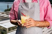 Refreshing Cocktail. Bearded Waiter Wearing Plain Pink Shirt Bringing Refreshing Cocktail With Spicy poster