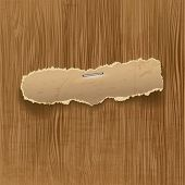Torn paper on wooden background with place for your message, eps10