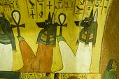 foto of ankh  - Ancient Egyptian wall painting of Anubis gods sitting holding Ankh keys - JPG