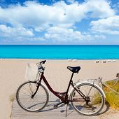 stock photo of tanga  - Bicycle in formentera beach on Balearic islands at Levante East Tanga - JPG