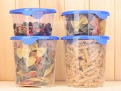 foto of tupperware  - Filled plastic containers on wooden background - JPG