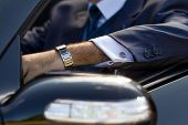 foto of posh  - Posh cufflinks on his shirt expensive watch on his arm power in his hands - JPG