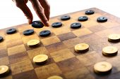 pic of draught-board  - Color shot of a vintage draughts or checkers board game - JPG