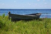 picture of boggy  - Old traditional fishing wooden boat on the lake bank near Kargopol in north Russia - JPG