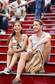 Dating multiracial tourist couple in New York City, Manhattan on the red stairs and steps on Times S