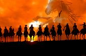 stock photo of cowboys  - A group of silhouetted cowboys ride off into the sunset with an eagle and horse in the background - JPG