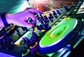 image of mixer  - Dj mixes the track in the nightclub at party - JPG