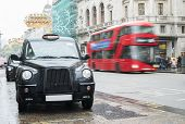 picture of hackney  - Taxi in London and red bus on the background - JPG