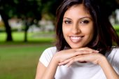 picture of east-indian  - Young beautiful indian college student studying outdoors on campus - JPG