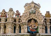 stock photo of saraswati  - The statue of the goddess sits on top of the Dodda Basavana Gudi Temple in Bengaluru - JPG