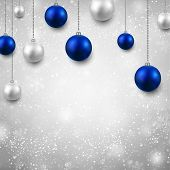 stock photo of fallen  - Winter grey background with silver and blue christmas balls - JPG