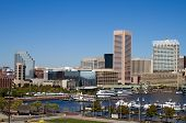 stock photo of marina  - Downtown Baltimore Maryland city inner harbor skyline showing the marina buildings and business on a clear sunny day.