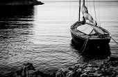 foto of shoreline  - sailing boat anchoring and moored at land in calm water - JPG