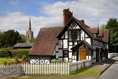 image of english cottage garden  - Cottage and church at Ombersley village, Worcestershire, England. ** Note: Slight graininess, best at smaller sizes - JPG