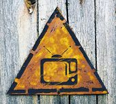 picture of televisor  - TV Set Icon on Weathered Triangular Yellow Warning Sign - JPG