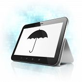 Safety concept: Umbrella on tablet pc computer