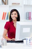 Confident Female Executive With Headset On At Her Desk