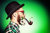 pic of peace-pipe  - Extravagant man with a beard of flowers wearing elegant bowler hat and smoking a pipe - JPG