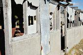 picture of derelict  - derelict building with broken concrete fibro and iron walls - JPG