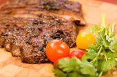 stock photo of flank steak  - Whole Chipotle Grilled Flank steak on wood cutting board