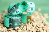 image of coffee crop  - Raw green coffee beans and measuring tape - JPG