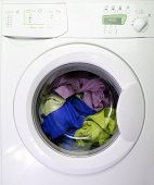picture of washing machine  - Colorful shirt and trousers in a white laundry - JPG