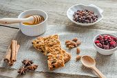 stock photo of sackcloth  - Homemade Granola Bars With Ingredients  On The Sackcloth - JPG