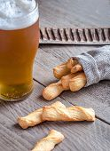 pic of guinness  - A Glass Of Beer With Breadsticks On the Wooden Table - JPG