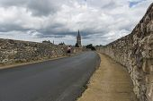 stock photo of street-walker  - Road Church and stroller on a black road in Saint - JPG