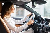 picture of driving  - Young woman driving her car - JPG