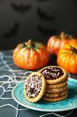 foto of spiderwebs  - Tasty Halloween cookies on plate - JPG