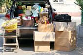 image of nomads  - Moving boxes and suitcases in trunk of car - JPG