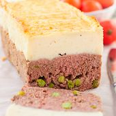 foto of meatloaf  - Beef Meatloaf with Green Peas Topped with Cheesy Mashed Potato close up square - JPG