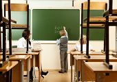 picture of epidemic  - School children are learning in the half empty classroom during epidemic of flu - JPG