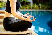 foto of padmasana  - Yoga Meditation hand by pool lotus pose  - JPG