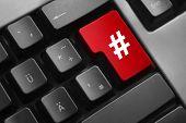 stock photo of hash  - dark grey keyboard red enter button hash symbol - JPG