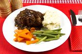 pic of lamb shanks  - Cooked lamb shanks with gravy and vegetables - JPG