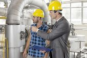 image of inspection  - Worker with supervisor inspecting industrial area - JPG