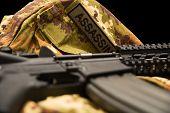 stock photo of m4  - A M4 Carabine on italian uniform  - JPG