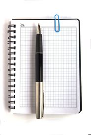 image of stenography  - Ink pen and paper clip on white notebook page - JPG