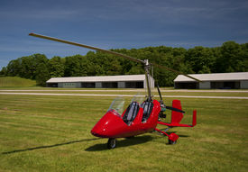 picture of ultralight  - Red open-cockpit autogyro parked at the airfield ** Note: Soft Focus at 100%, best at smaller sizes - JPG