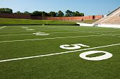 pic of football field  - American football field with goal post in background - JPG