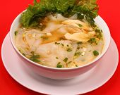 foto of glass noodles  - Glass noodle soup with chicken and beansprouts on a red background - JPG